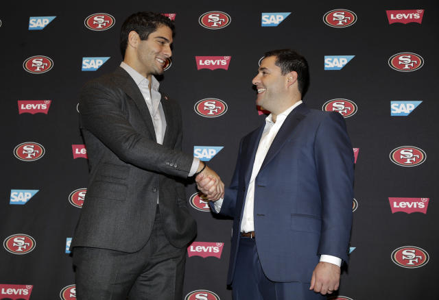 San Francisco 49ers quarterback Jimmy Garoppolo, left, shakes hands with owner Jed York after an NFL football press conference Friday, Feb. 9, 2018, in Santa Clara, Calif. Garoppolo has signed a five-year contract with the 49ers worth a record-breaking $137.5 million. (AP Photo/Marcio Jose Sanchez)