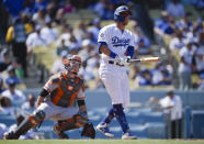 Los Angeles Dodgers' Matt Beaty, right, looks up after hitting a two-run home run during the fourth inning of a baseball game as San Francisco Giants catcher Buster Posey reacts in Los Angeles, Sunday, Sept. 8, 2019. (AP Photo/Kelvin Kuo)