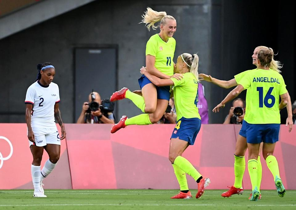 Sweden's Stina Blackstenius jumps into the arms of a teammate after scoring a goal.
