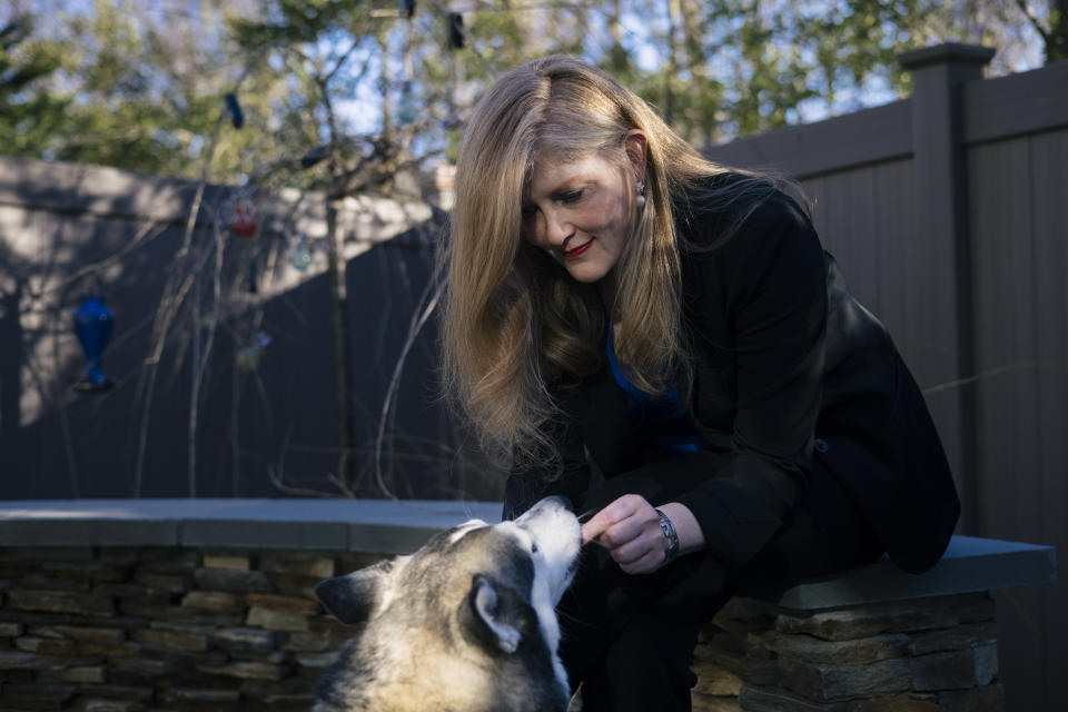 Lisa Sales with her dog Halo