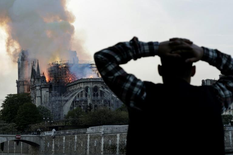 Anxious passers-by watched the landmark cathedral burn