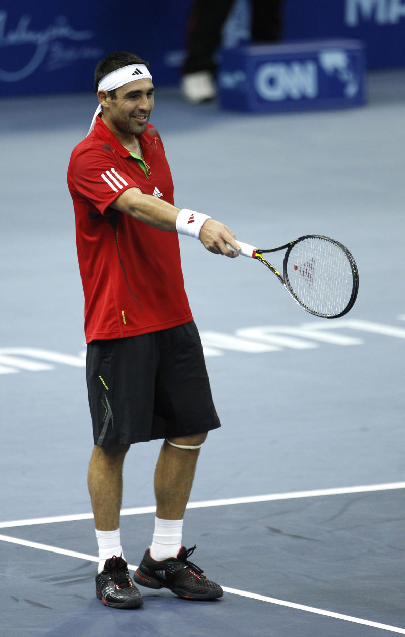 Marcos Baghdatis from Cyprus gestures as he challenges a decision of a line umpire during match against Jurgen Melzer from Austria at their quarterfinal round match at the Malaysian Open tennis tournament in Kuala Lumpur, Malaysia, Friday, Sept. 30, 2011.  (AP Photo/Vincent Thian)