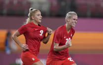 Canada's Adriana Leon, left, celebrates with teammate Sophie Schmidt after scoring her side's opening goal against Great Britain during a women's soccer match at the 2020 Summer Olympics, Tuesday, July 27, 2021, in Kashima, Japan. (AP Photo/Fernando Vergara)