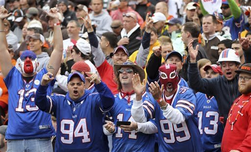 Buffalo Bills fans cheer after a Bills' touchdown in the fourth quarter of an NFL football game against the Cleveland Browns, Sunday, Sept. 23, 2012, in Cleveland. (AP Photo/Tony Dejak)