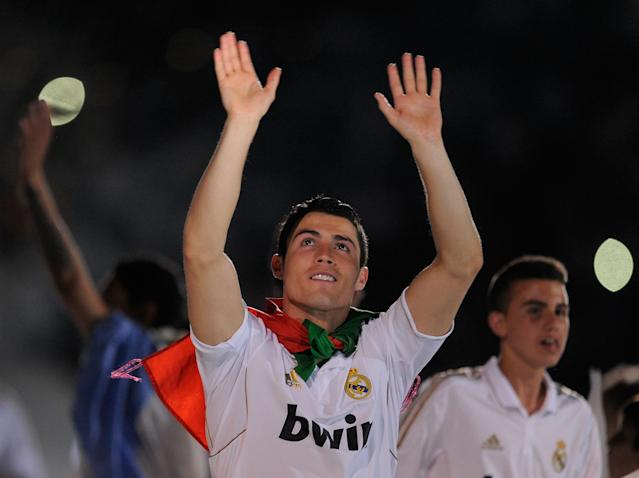 MADRID, SPAIN - MAY 13: Cristiano Ronaldo of Real Madrid CF salutes the fans as he celebrates winning the La Liga title after the La Liga match between Real Madrid CF and RCD Mallorca at Estadio Santiago Bernabeu on May 13, 2012 in Madrid, Spain. (Photo by Denis Doyle/Getty Images)