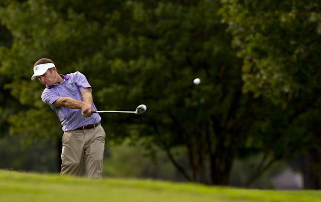 Bill Williamson plays his second shot at the 16th hole during the semifinal round of match play at the U.S. Mid-Amateur Championship golf tournament at the Country Club of Birmingham in Birmingham, Ala., Wednesday, Oct. 9, 2013. (AP Photo/USGA, Steve Gibbons)