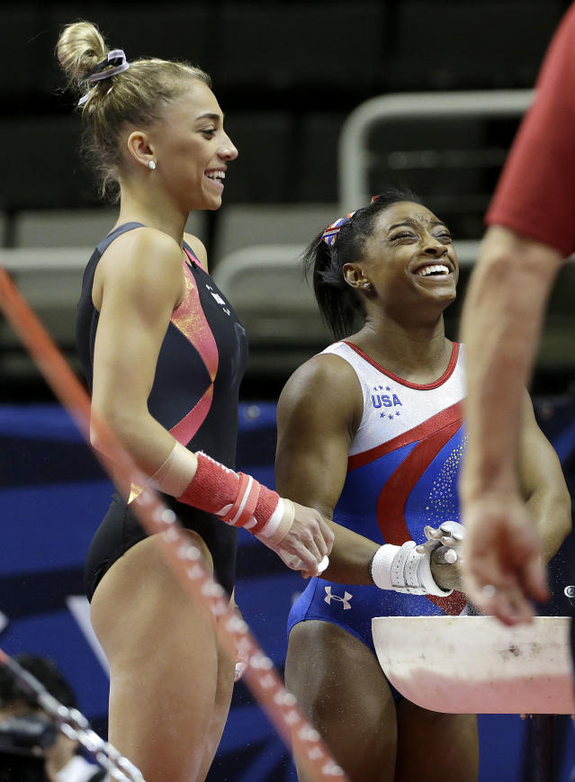 Simone Biles, right, smiles during practice at the U.S. Olympic trials. (AP Photo)