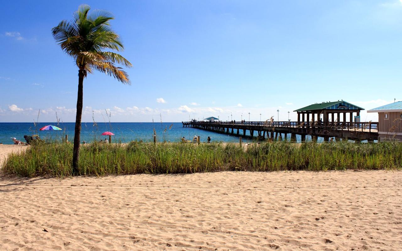 <p>Sure, Miami, Fort Lauderdale, and Palm Beach are popular destinations in Florida, but this lesser-known beach town is far more affordable. It's hidden on Florida's east coast, tucked between Fort Lauderdale and Pompano Beach, and visiting makes you feel like you've stepped back in time. </p> <p>While in town, be sure to take a stroll down the beach pavilion to the pier. You can walk through Anglin's Square, which is filled with cafes, bars, restaurants, and gelato shops — visit at night to enjoy the bar scene. </p>