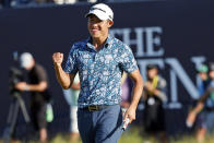 FILE - In this July 18, 2021, file photo, United States' Collin Morikawa celebrates on the 18th green after winning the British Open Golf Championship at Royal St George's golf course Sandwich, England. Morikawa, who was an amateur when the last Ryder Cup was played in 2018, has since then has won two majors, a World Golf Championship and led the U.S. standings in his first year of eligibility. The pandemic-delayed 2020 Ryder Cup returns the United States next week at Whistling Straits along the Wisconsin shores of Lake Michigan. (AP Photo/Peter Morrison, File)