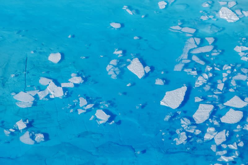mFILE PHOTO: Chunks of ice float inside of meltwater pools on top of the Helheim glacier near Tasiilaq, Greenland