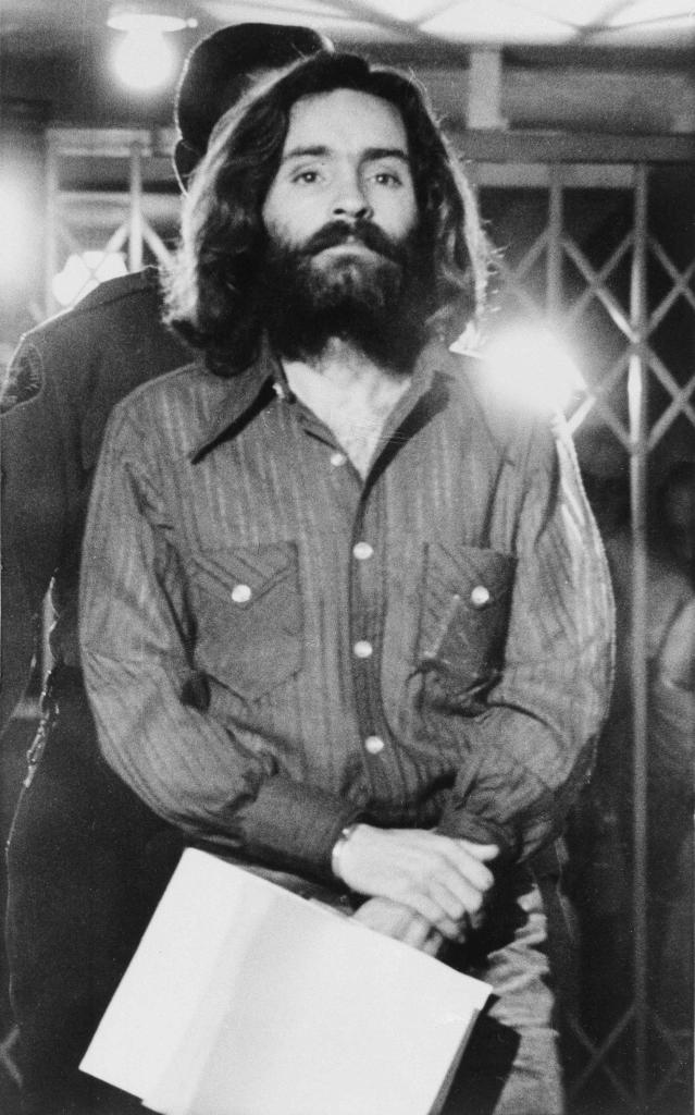 "Charles Manson leaves a Los Angeles courtroom after telling a judge ""lies have been told"" about him, on Dec. 22, 1969. (AP Photo/Wally Fong)"