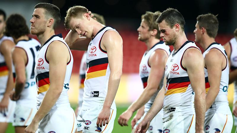 Pictured here, the Adelaide Crows after their defeat to Gold Coast.