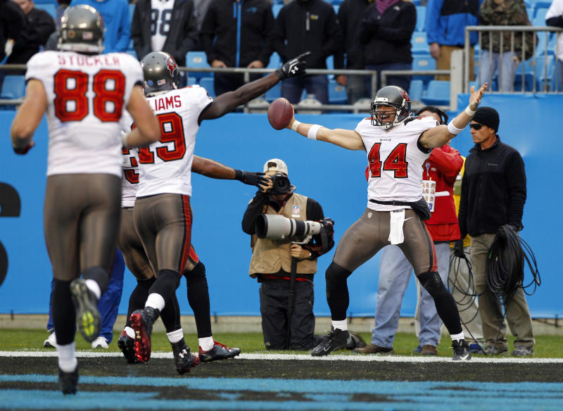 Tampa Bay Buccaneers' Dallas Clark (44) reacts after his game-winning touchdown catch against the Carolina Panthers in overtime of an NFL football game in Charlotte, N.C., Sunday, Nov. 18, 2012. Tampa won 27-21. (AP Photo/Chuck Burton)