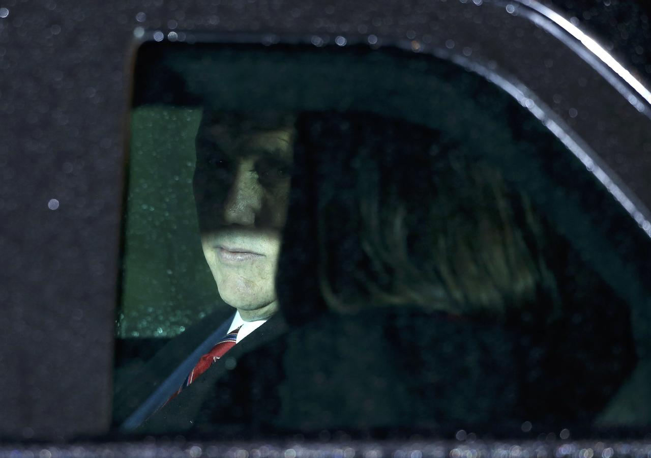U.S. Vice President Mike Pence and his wife Karen are pictured as they sit inside a limousine following their arrival in Munich, Germany, February 17, 2017.    REUTERS/Michaela Rehle TPX IMAGES OF THE DAY