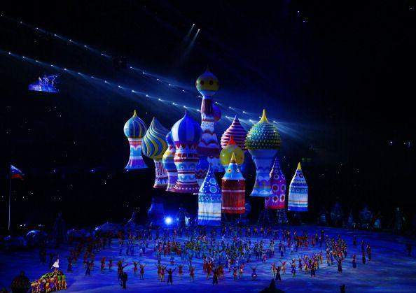 <p>Inflatable figures representing St. Basil's cathedral drift in the air above dancers. </p>