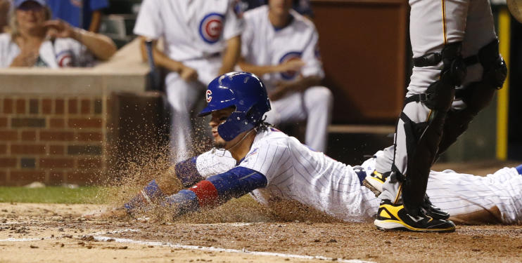 Javier Baez slides in with another clean steal of home plate against the Pirates. (AP)
