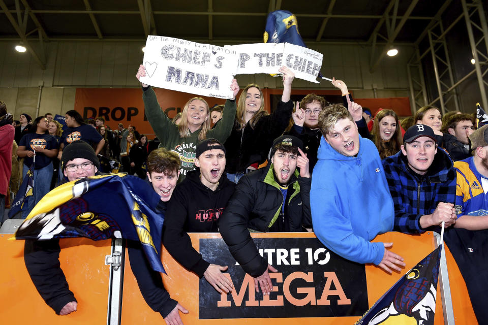 Spectators cheer during the Super Rugby Aotearoa rugby game between the Highlanders and Chiefs in Dunedin, New Zealand, Saturday, June 13, 2020. Super Rugby Aotearoa is the first major rugby union tournament to resume since the COVID-19 outbreak and one of the first major sports events in the world at which there will be no limitation on crowd size. (Joe Allison /Photosport via AP)
