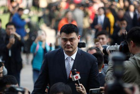 FILE PHOTO: Yao Ming, a delegate and a former NBA player arrives near the Great Hall of the People before the opening session of the Chinese People's Political Consultative Conference (CPPCC) in Beijing, China. REUTERS/Thomas Peter/File Photo