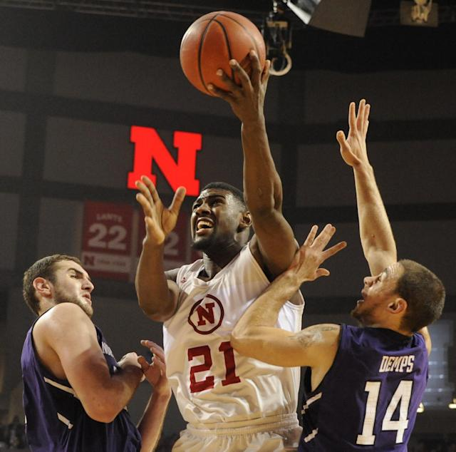 Nebraska forward Leslee Smith (21) shoots the ball over Northwestern guard Tre Demps (14) during an NCAA college basketball game in Lincoln, Neb., Saturday, March 1, 2014. (AP Photo/Dave Weaver)