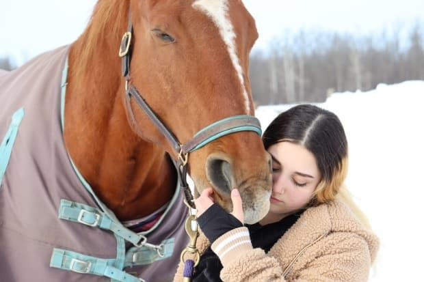 Denzel offers a supportive muzzle to 14-year-old Maria.