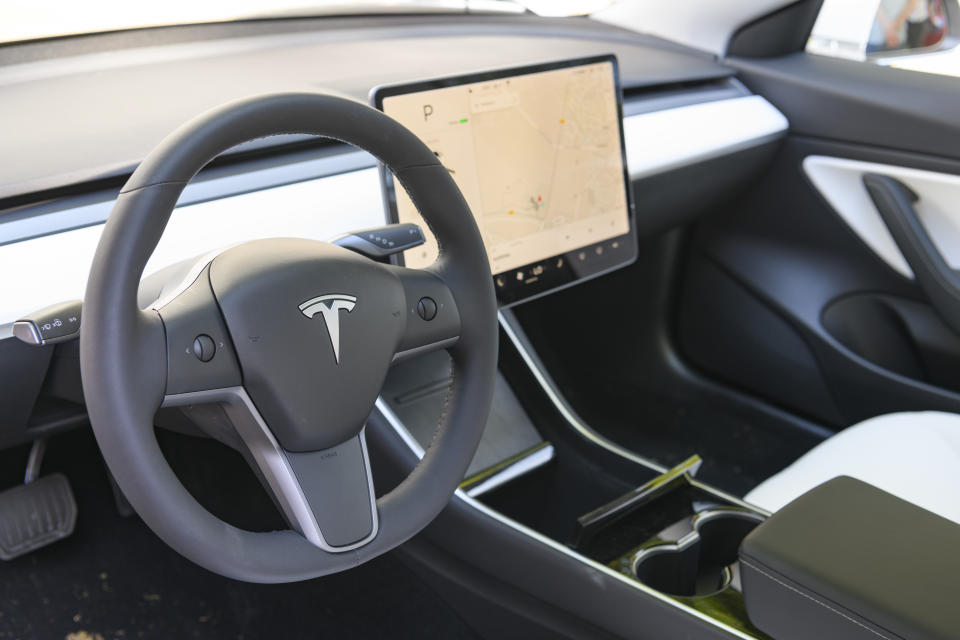 BAARN, NETHERLANDS - AUGUST 25: Tesla Model 3 compact full electric car interior with a large touch screen on the dahsboard on display at the 2019 Concours d'Elegance at palace Soestdijk on August 25, 2019 in Baarn, Netherlands. This is the first time the Concours d'Elegance will be held at Soestdijk Palace and the 2019 edition was held on 24-25 August. (Photo by Sjoerd van der Wal/Getty Images)