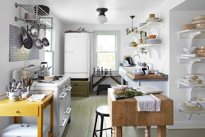"""<p>The kitchen in this upstate <a href=""""https://www.countryliving.com/home-design/house-tours/g1330/white-room-decorating-ideas/"""" rel=""""nofollow noopener"""" target=""""_blank"""" data-ylk=""""slk:New York house"""" class=""""link rapid-noclick-resp"""">New York house</a> features a white 1950s refrigerator. """"Our mothers warned us about defrosting,"""" the owner jokes, """"but we love the look."""" A white midcentury stove, painted floors, an antique butcher block, and a salvaged cast-iron sink magnify the room's farmhouse charm.</p>"""