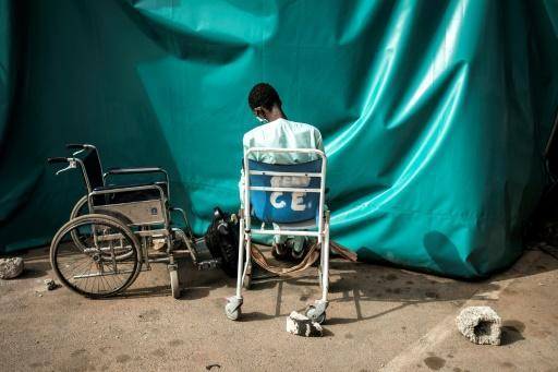A patient sits waiting to be helped inside the Pikine Hospital in Dakar as COVID-19 coronavirus cases slowly increase in Senegal