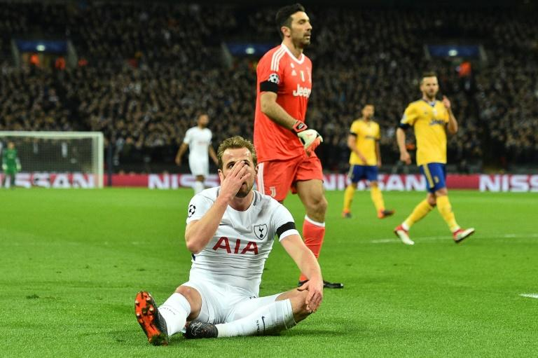 Tottenham's Harry Kane holds his head in his hands after a chance goes begging against Juventus