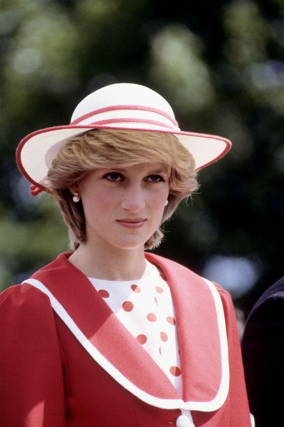 <p>In a polka-dot top, red jacket and matching hat during the Royal Tour of Canada.</p>