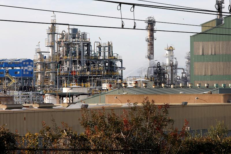 General view of the IQOXE petrochemical factory the morning after a blast in Tarragona. Source: EPA