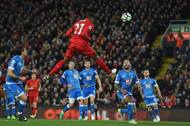 Liverpool's striker Divock Origi jumps to head their second goal during the English Premier League football match between Liverpool and Bournemouth at Anfield in Liverpool, north west England on April 5, 2017 (AFP Photo/PAUL ELLIS )