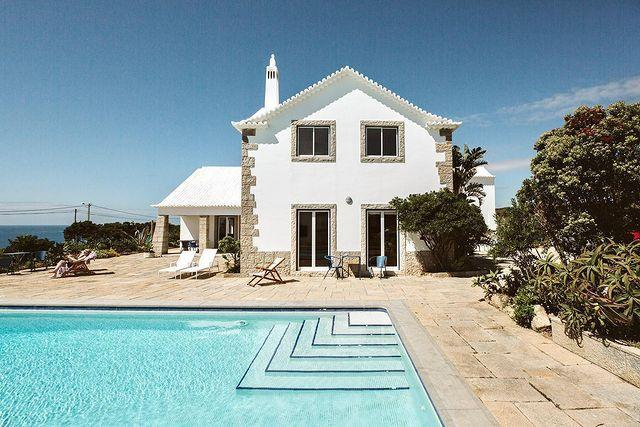 """<p>It's all about location, location, location at Outpost, a former private house perched on top of a cliff with incredible views of the Atlantic Ocean. Just a 40-minute drive from Lisbon, it's now available as six beautifully furnished holiday apartments, with a communal pool, tennis court and gardens.</p><p><a href=""""https://www.welcomebeyond.com/property/outpost-casa-das-arribas/"""" rel=""""nofollow noopener"""" target=""""_blank"""" data-ylk=""""slk:From €165pn (£142.18), based on two sharing."""" class=""""link rapid-noclick-resp"""">From €165pn (£142.18), based on two sharing.</a></p><p><a href=""""https://www.instagram.com/p/CMBwFlssvML/"""" rel=""""nofollow noopener"""" target=""""_blank"""" data-ylk=""""slk:See the original post on Instagram"""" class=""""link rapid-noclick-resp"""">See the original post on Instagram</a></p>"""