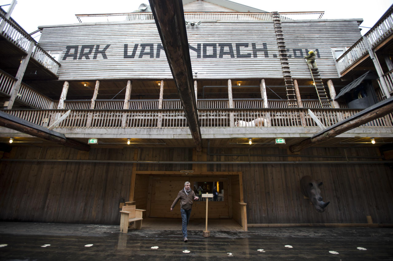 Johan Huibers, center, shows journalists the inside of the full scale replica of Noah's Ark in Dordrecht, Netherlands, Monday Dec. 10, 2012. (AP Photo/Peter Dejong)