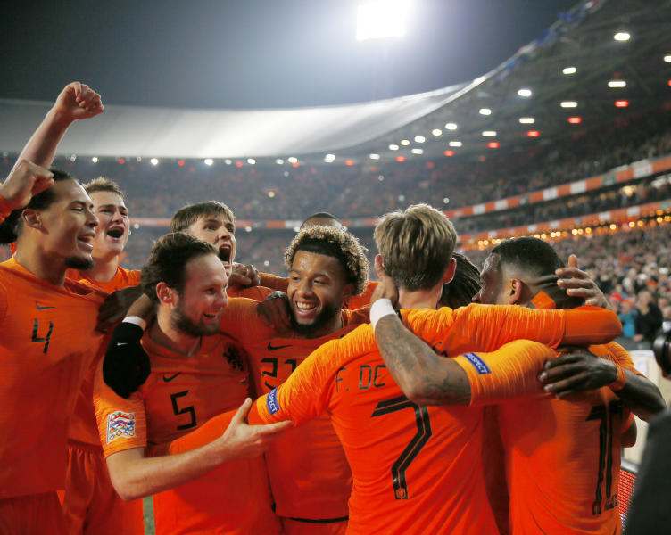 Netherlands players celebrate scoring 2-0 during the international friendly soccer match between The Netherlands and France at De Kuip stadium in Rotterdam, Netherlands, Friday, Nov. 16, 2018. (AP Photo/Peter Dejong)