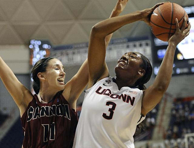 Connecticut's Morgan Tuck drives toward the basket as Gannon's Jen Papich, left, defends during the second half of an NCAA college exhibition basketball game, Friday, Nov. 1, 2013, in Storrs, Conn. Connecticut won 101-35. (AP Photo/Jessica Hill)