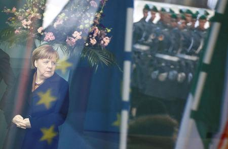 German Chancellor Angela Merkel waits at the chancellery in Berlin, Germany, March 20, 2018. REUTERS/Fabrizio Bensch TPX IMAGES OF THE DAY