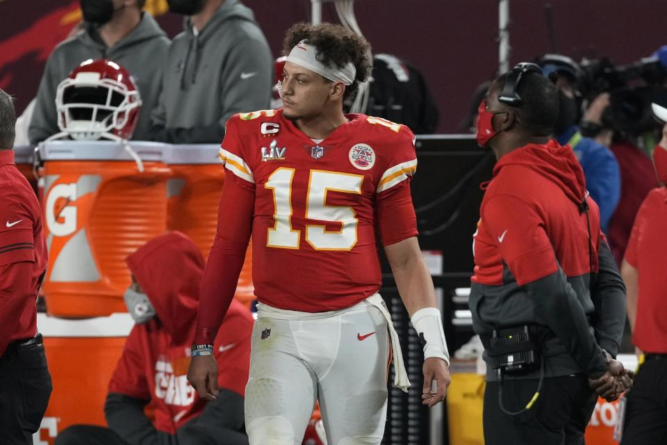 Kansas City Chiefs quarterback Patrick Mahomes watches from the sideline during the second half of the NFL Super Bowl 55 football game against the Tampa Bay Buccaneers Sunday, Feb. 7, 2021, in Tampa, Fla. (AP Photo/Chris O'Meara)