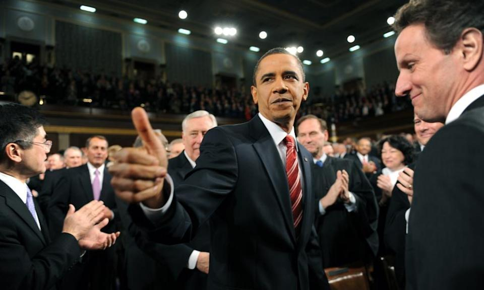 President Barack Obama walks down the center aisle greeting members of Congress on his way to deliver his State of the Union address on Capitol Hill in Washington on 27 January 2010.