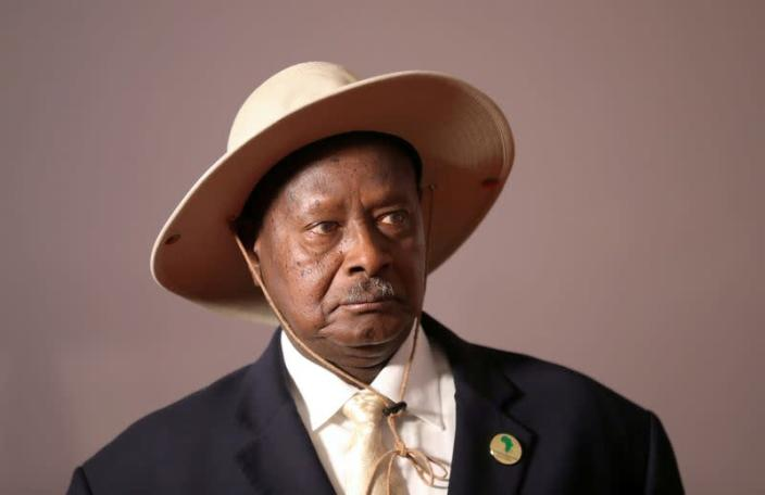 FILE PHOTO: Uganda's President Yoweri Museveni arrives for a group picture at the BRICS summit meeting in Johannesburg