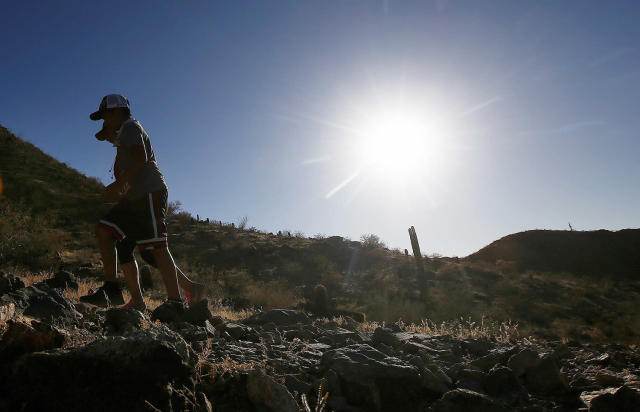<p>Hikers brave the afternoon sun as the temperatures hit 110-degrees June 15, 2017, in Phoenix. (Ross D. Franklin/AP) </p>