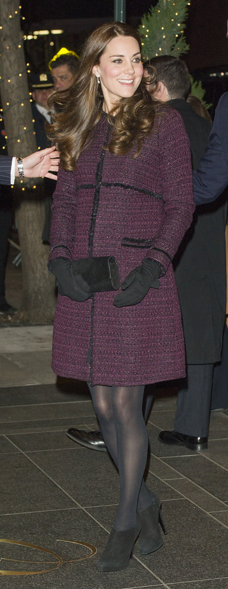 <p>Kate opted for a bouclé coat by Seraphine Maternity for her arrival in New York. She carried a black clutch by Stuart Weitzman and wore black booties and wool gloves from Cornelia James.</p><p><i>[Photo: PA]</i></p>