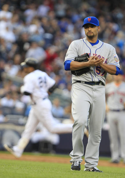 New York Mets' Johan Santana (57) reacts as New York Yankees' Robinson Cano (24) runs the bases after hitting a two-run home run during the second inning of an interleague baseball game Friday, June 8, 2012, in New York. (AP Photo/Frank Franklin II)