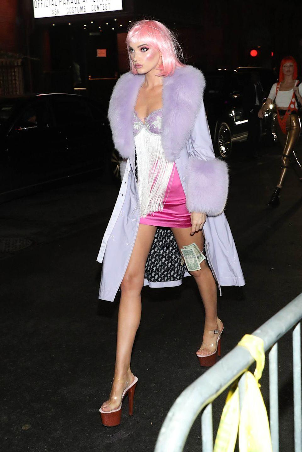 <p>Elsa Hosk struts the streets as the coquettish and captivating Jane in <em>Closer</em> at Heidi Klum's 2019 Halloween Party in New York City.</p>