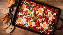 "<p>Shakshuka is by far the easiest way to impress your guests at brunch. It's mildly spicy, full of flavour, and has perfectly runny eggs. The rich tomato sauce will balance those delicious <a href=""https://www.delish.com/uk/cooking/recipes/a29245017/banana-pancake-dippers-recipe/"" rel=""nofollow noopener"" target=""_blank"" data-ylk=""slk:Banana Pancakes"" class=""link rapid-noclick-resp"">Banana Pancakes</a> you're whipping up too. </p><p>Get the <a href=""https://www.delish.com/uk/cooking/recipes/a29949777/shakshuka-with-feta-and-parsley-recipe/"" rel=""nofollow noopener"" target=""_blank"" data-ylk=""slk:Shakshuka"" class=""link rapid-noclick-resp"">Shakshuka</a> recipe.</p>"