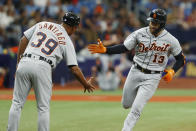 Detroit Tigers' Eric Haase (13) celebrates with third base coach Ramon Santiago after hitting a home run against the Tampa Bay Rays during the fourth inning of a baseball game Sunday, Sept. 19, 2021 in St. Petersburg, Fla. (AP Photo/Scott Audette)