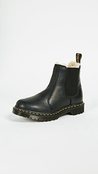 """<p><strong>Dr. Martens</strong></p><p>shopbop.com</p><p><strong>$150.00</strong></p><p><a href=""""https://go.redirectingat.com?id=74968X1596630&url=https%3A%2F%2Fwww.shopbop.com%2Fleonore-sherpa-chelsea-boots-dr%2Fvp%2Fv%3D1%2F1538006046.htm&sref=https%3A%2F%2Fwww.harpersbazaar.com%2Ffashion%2Ftrends%2Fg3124%2Fbest-snow-boots%2F"""" rel=""""nofollow noopener"""" target=""""_blank"""" data-ylk=""""slk:Shop Now"""" class=""""link rapid-noclick-resp"""">Shop Now</a></p><p>At this point, we all know how comfortable and long lasting Dr. Martens shoes are. Add these comfortable, low-heeled leather snow boots to your collection. </p>"""
