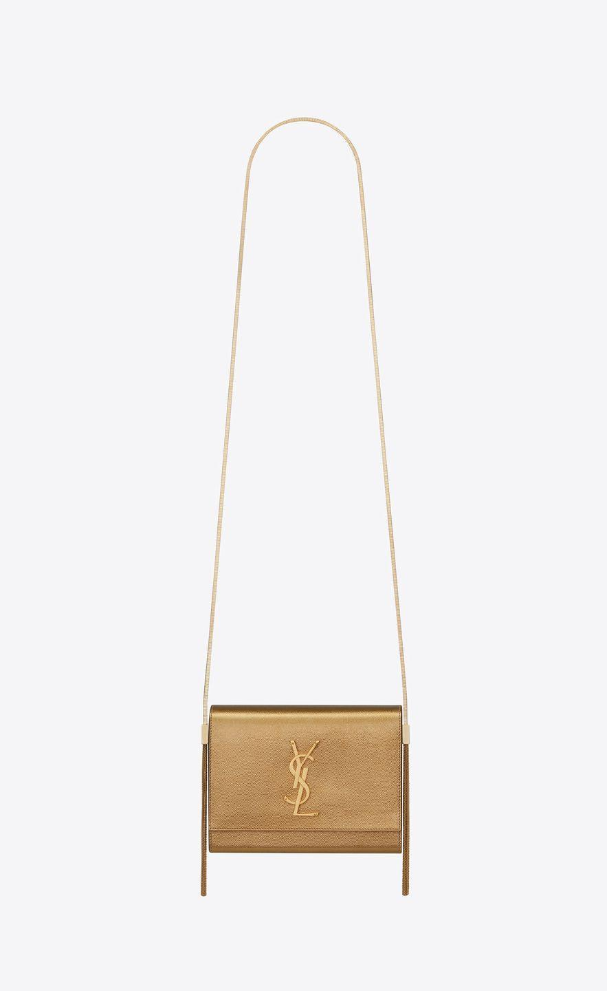 "<p>Bag, £1,630, Saint Laurent</p><p><a class=""link rapid-noclick-resp"" href=""https://www.ysl.com/gb/shop-product/women/handbags-monogram-kate-kate-box-bag-in-grain-de-poudre-embossed-metallic-leather_cod45493313hw.html#dept=women_bags_view_all"" rel=""nofollow noopener"" target=""_blank"" data-ylk=""slk:SHOP NOW"">SHOP NOW</a></p>"