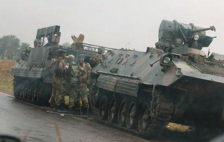 Soldiers stand beside military vehicles just outside Harare,Zimbabwe