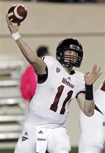 Massachusetts quarterback Mike Wegzyn (11) throws to a receiver in the first quarter of an NCAA college football game against Vanderbilt on Saturday, Oct. 27, 2012, in Nashville, Tenn. (AP Photo/Wade Payne)