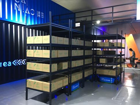 Cainiao Network, the logistics business of Alibaba Group Holding, shows off its automated guided vehicles, which are able to carry shelves weighing half a metric tonne, at last year's edition of the Global Smart Logistics Summit in Hangzhou, Zhejiang province. Photo: Zen Soo